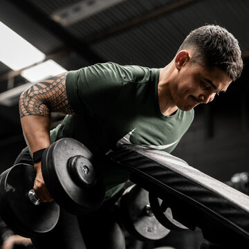 Strong male dumbbell row