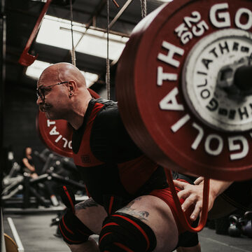 Strong male squatting powerlifting